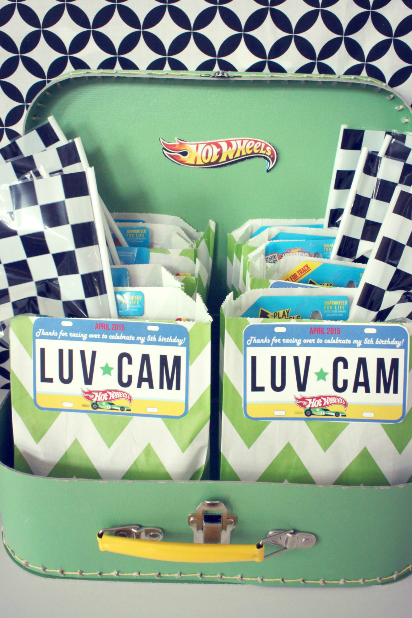 Party favor with checkered flag from Hot Wheels Birthday Party | Black Twine | The Party Porch