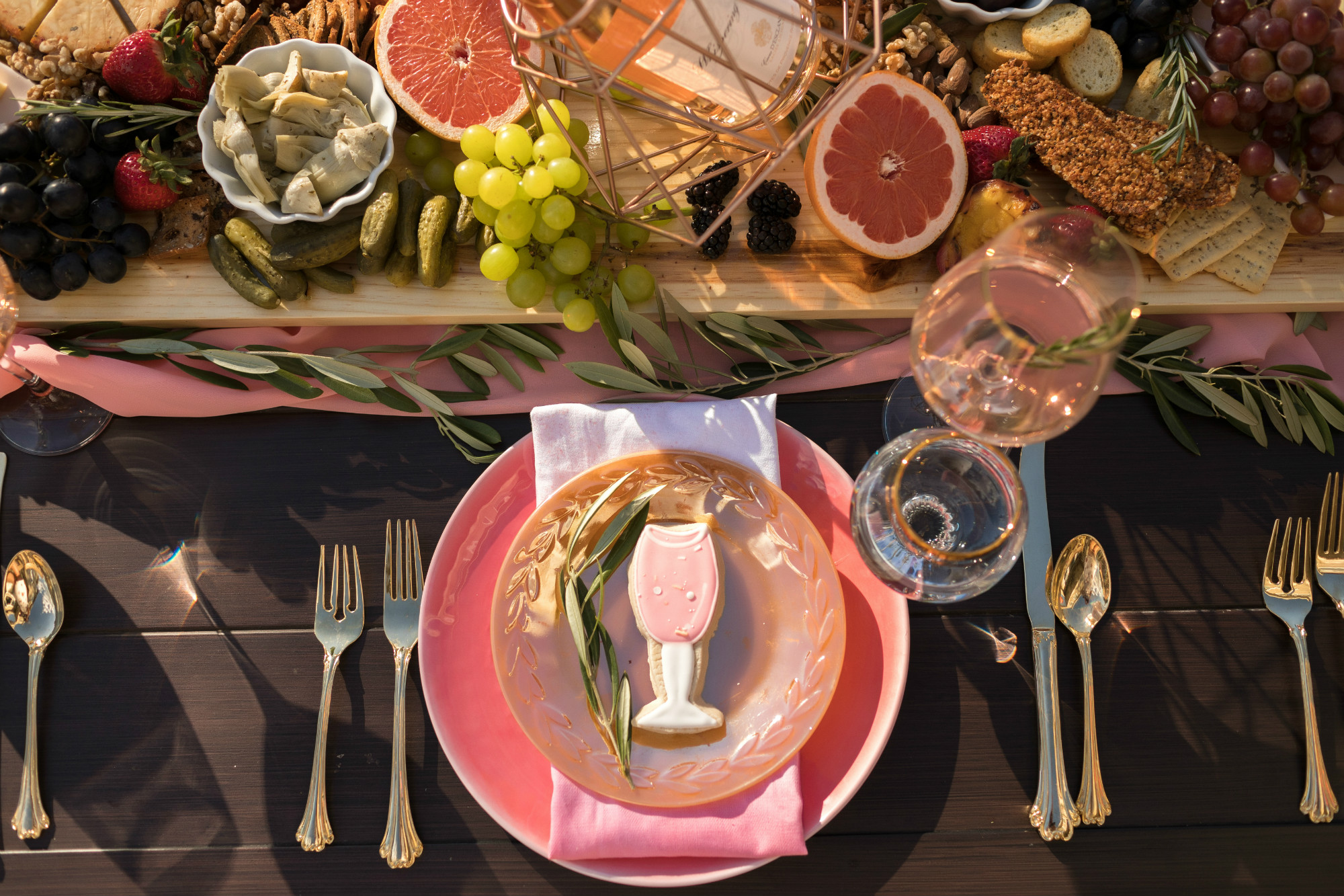 Place setting and charcuterie board from One Stylish Party Rose All Day Dinner Party | Black Twine