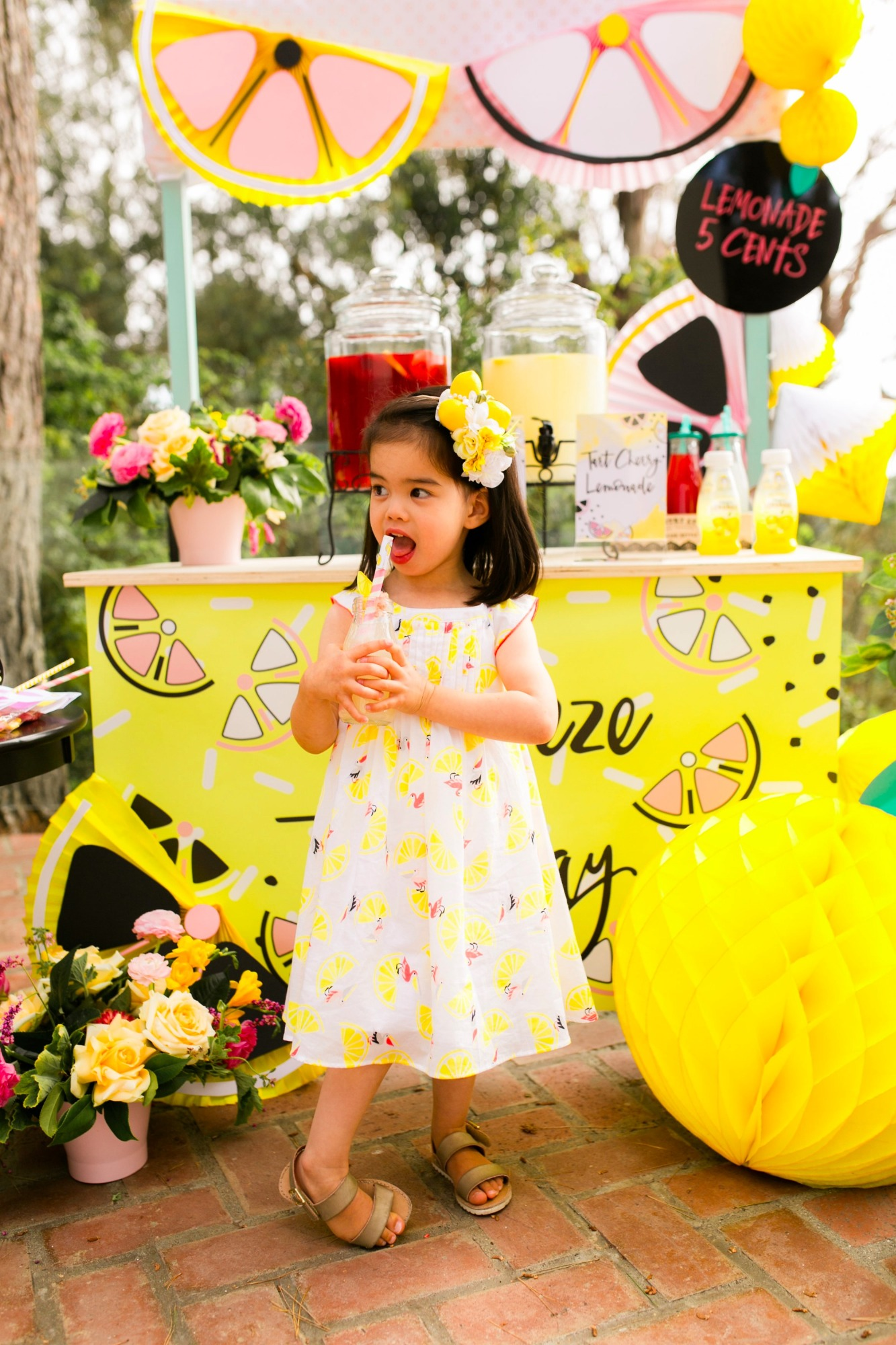 Birthday girl and lemonade stand from Lemonade Stand Birthday Party by Forrest and J. | Black Twine