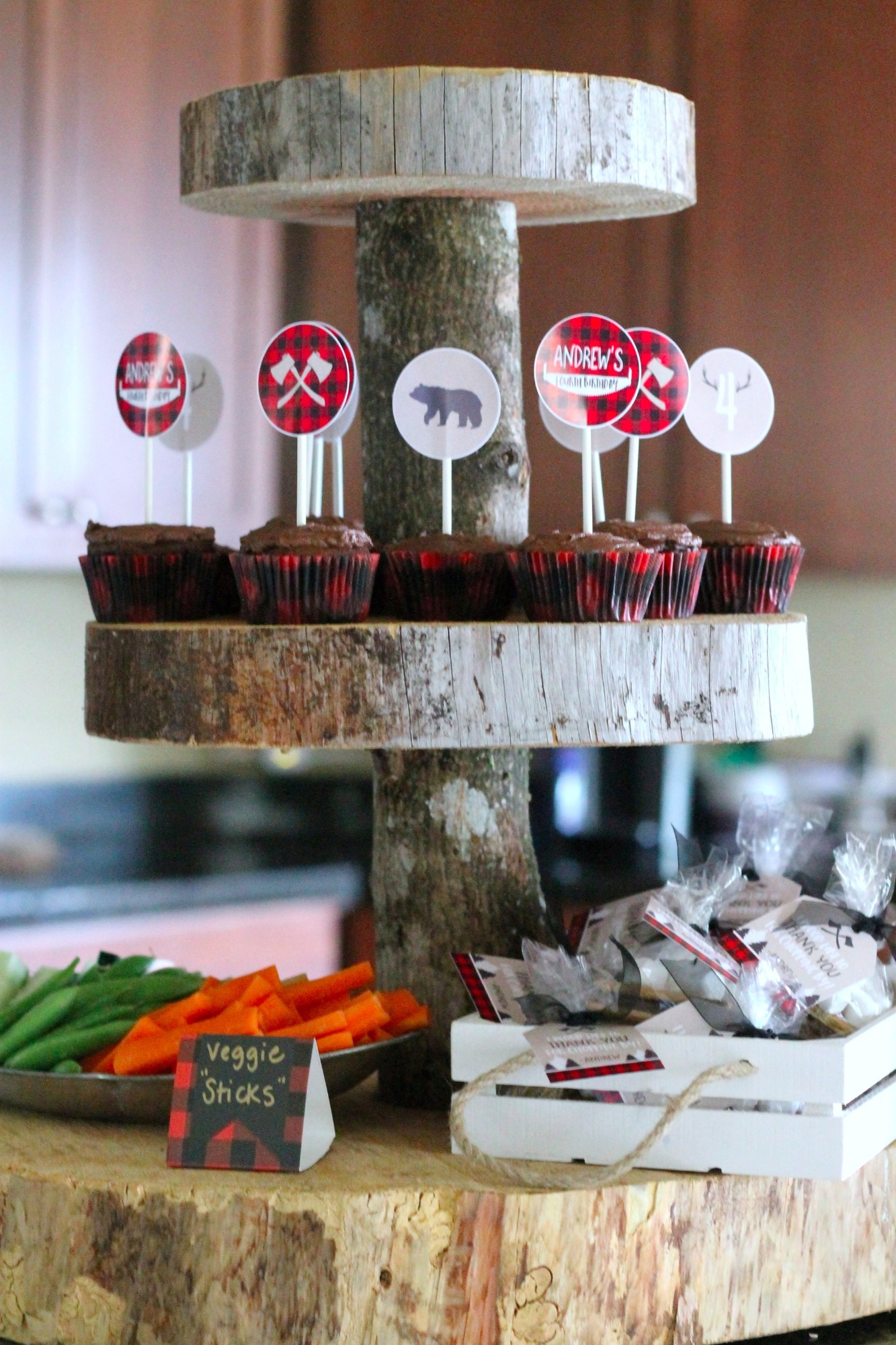 Cupcakes and Veggie Sticks on Food Table for Lumberjack Party by AK Party Studio | Black Twine