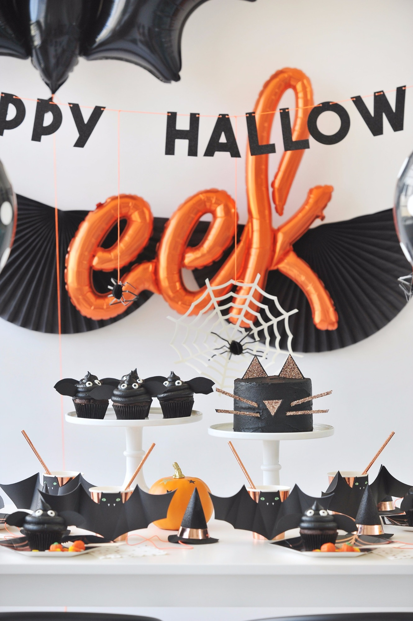 Close-up of Table and Balloons from Halloween Party by Happy Wish Company | Black Twine