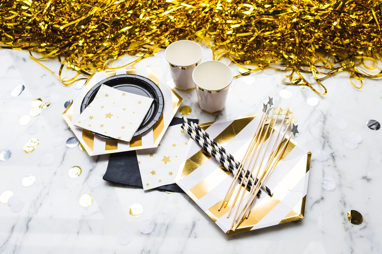 Festive gold and white paperware for New Year's Eve Party