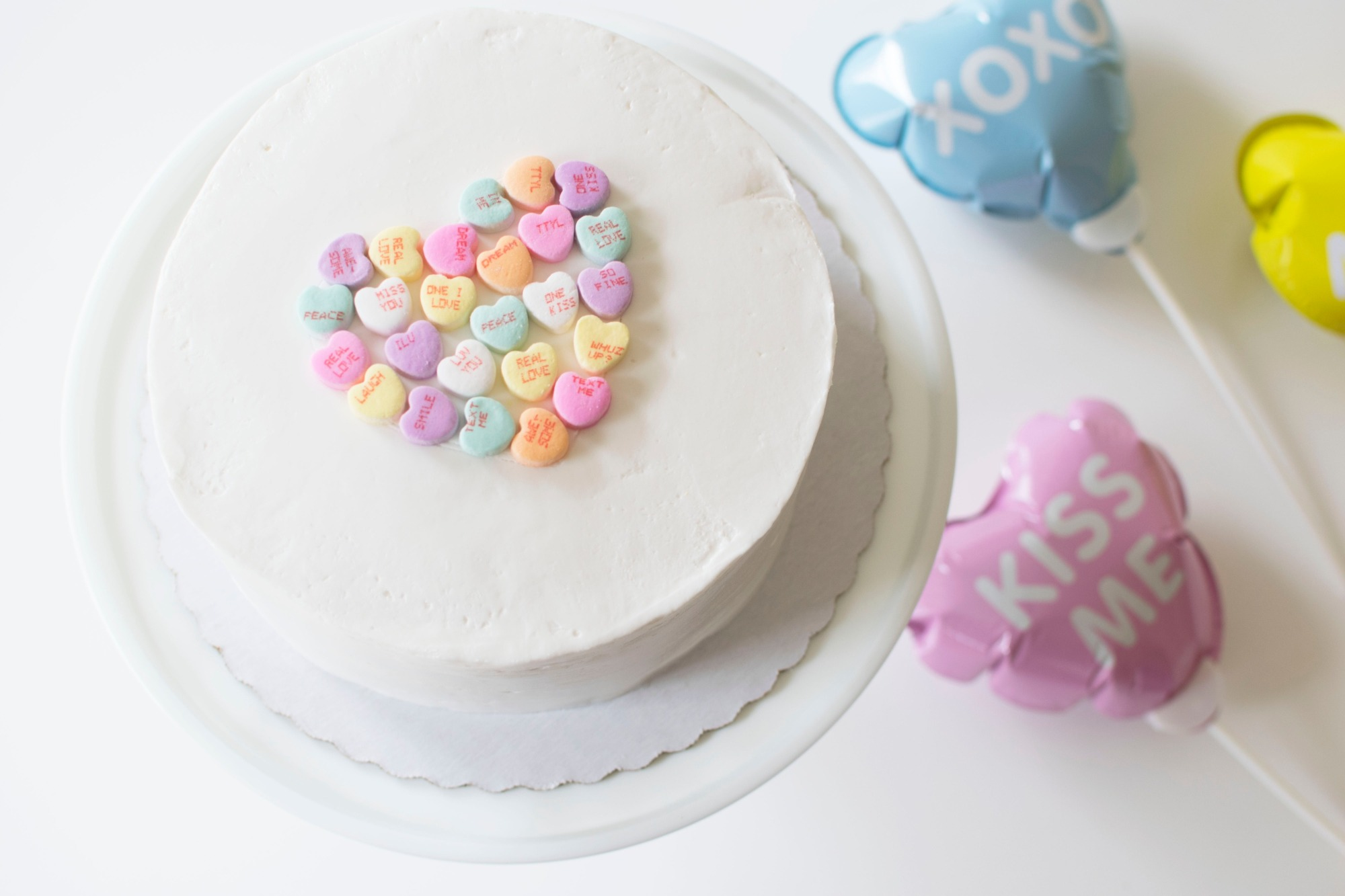Cake from Conversation Hearts Party styled by Twinkle Twinkle Little Party | Black Twine