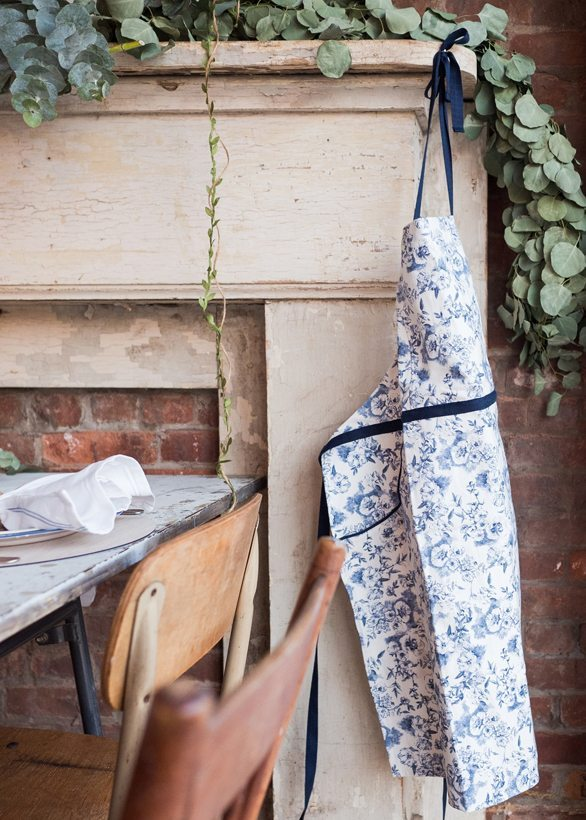 How to host a baby shower | Maman blue and white apron