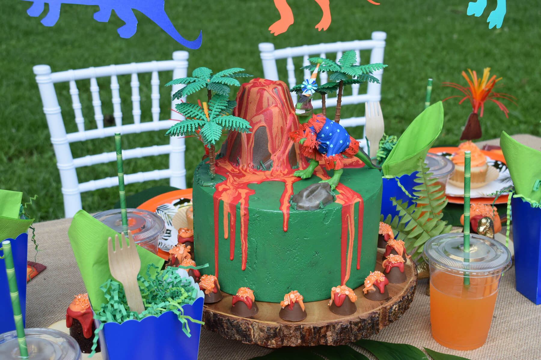 Place Setting with Volcano Cake from Dinosaur Stomp Birthday Party styled by A Party Made Perfect | Black Twine