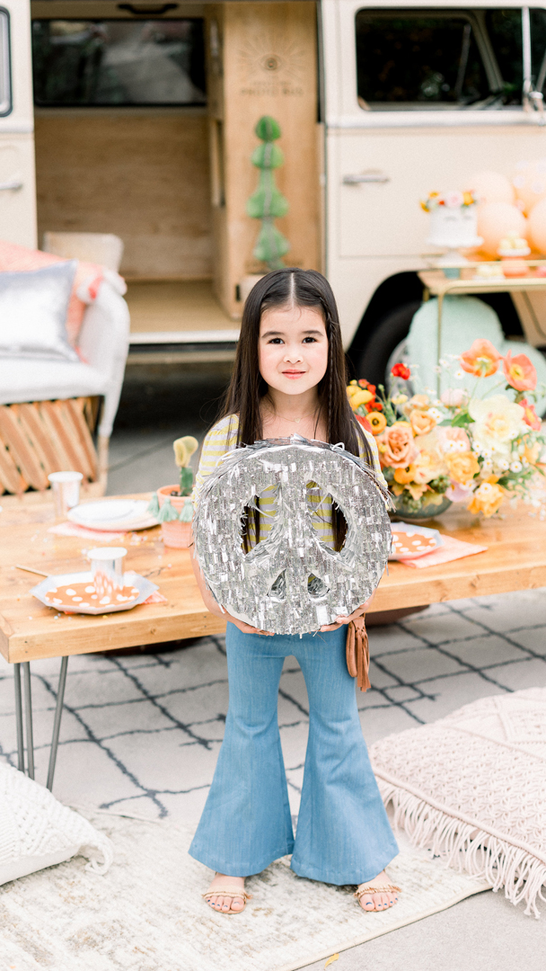 Kid Holding a Peace Piñata from Peace, Love & Party styled by Deets & Things | Black Twine