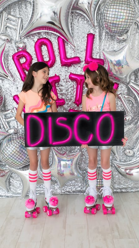Kids Holding Disco Sign from a Roller Disco Derby Party In Collaboration with Geese & Ganders and Styled by La Petite Fete | Black Twine