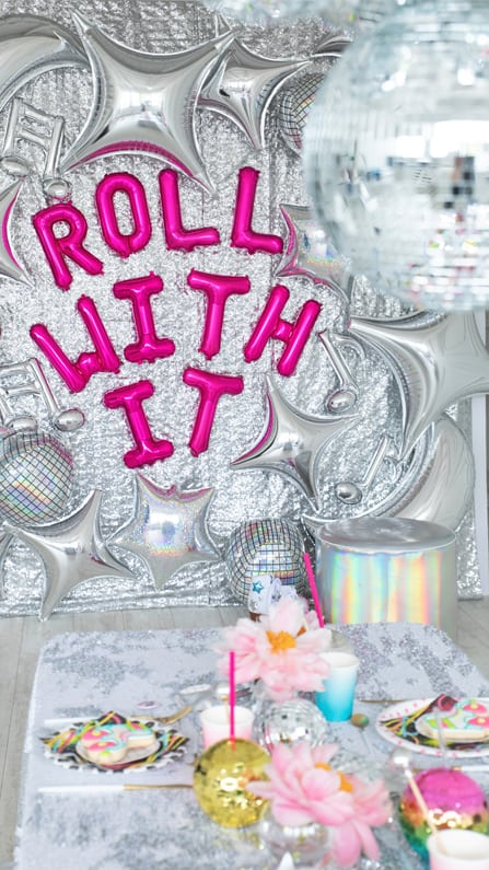 Roll With It Sign and Tablescape from a Roller Disco Derby Party In Collaboration with Geese & Ganders and Styled by La Petite Fete | Black Twine
