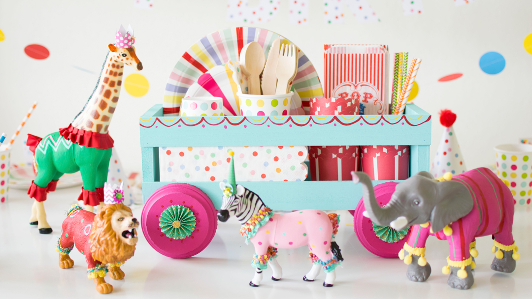 Flatware Dispenser and Circus Animal Figures from Circus Animal Parade Party styled by Twinkle Twinkle Little Party | KikiBoxes | Black Twine