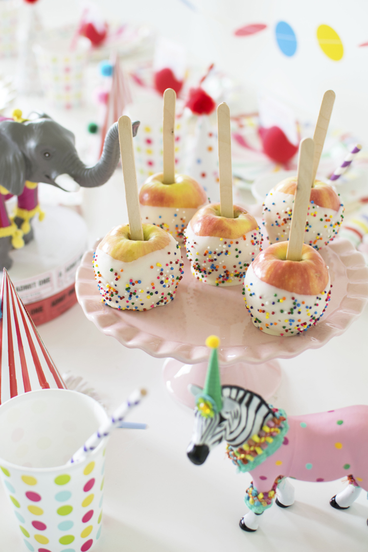 White Chocolate Coated Apples from Circus Animal Parade Party styled by Twinkle Twinkle Little Party | KikiBoxes | Black Twine