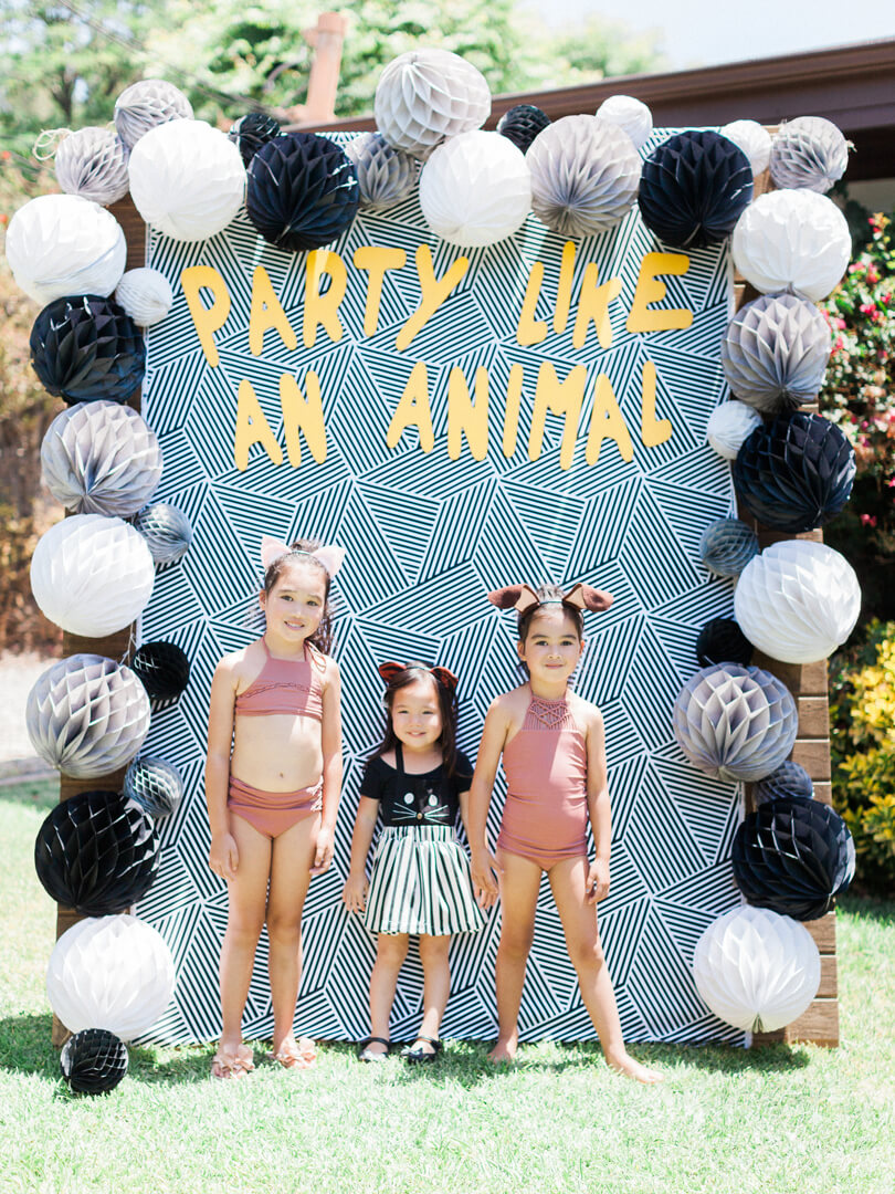 Party Like an Animal Backdrop with Kids from Party Like An Animal! Party Styled by Deets & Things | Black Twine
