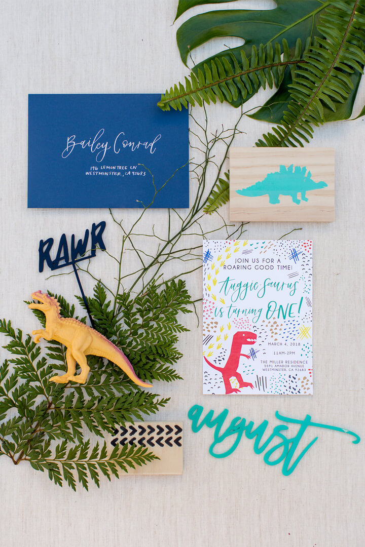 Invitations and Dinosaur Blocks from Dinomite Birthday Party Styled by Golden Arrow Events & Design | Black Twine