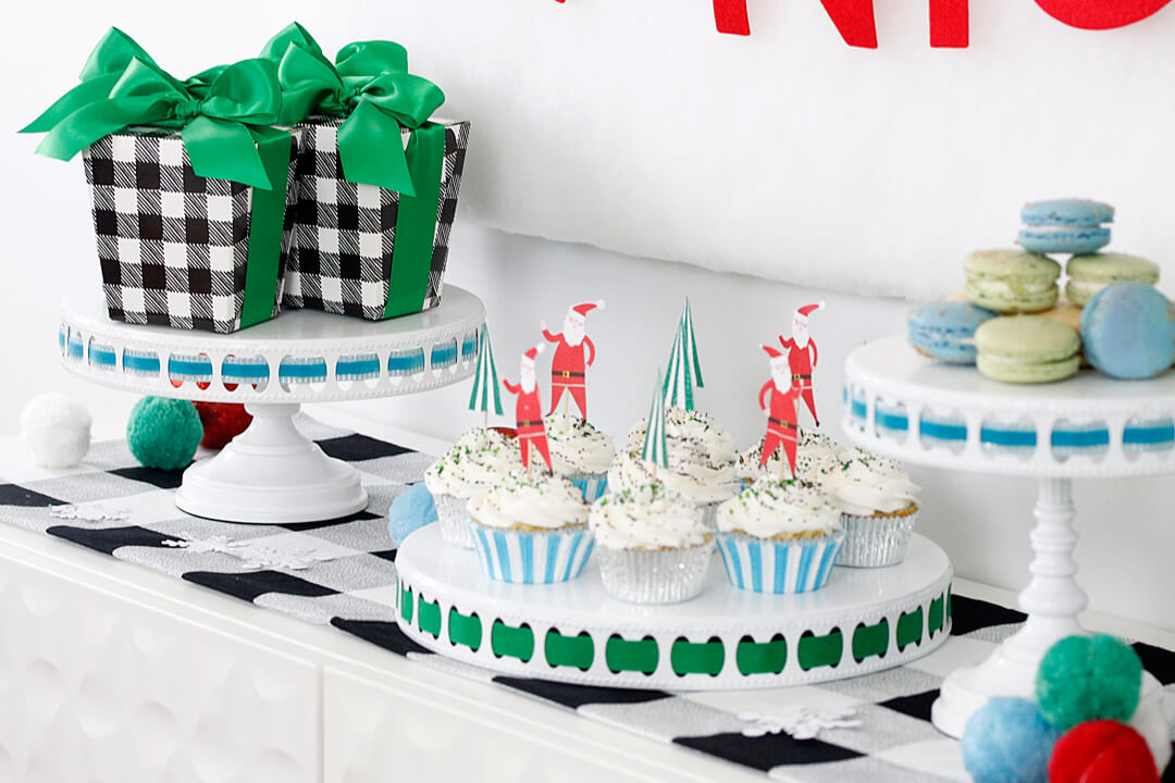 "Macarons, Cupcakes with Santa Claus Topper and Gift boxes from ""Dear Santa"" Party Styled by A Lovely Design 