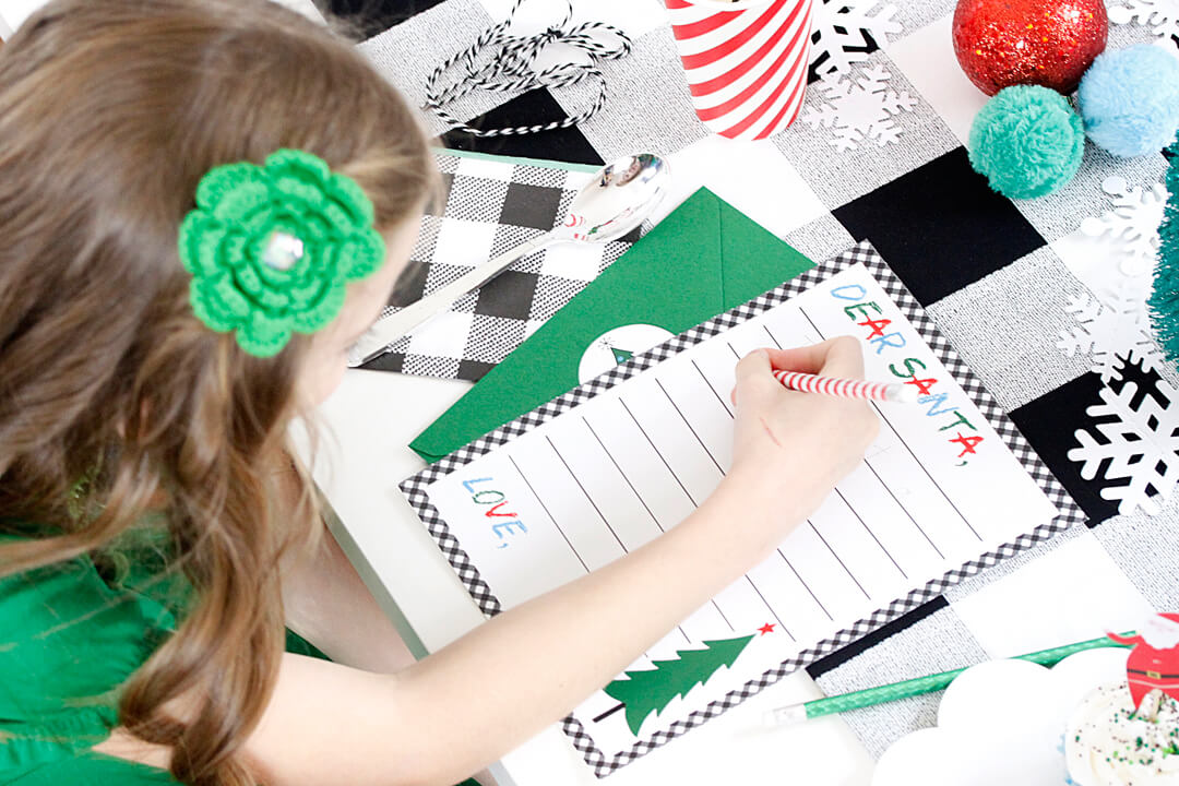 "Writing a Letter to Santa from ""Dear Santa"" Party Styled by A Lovely Design 