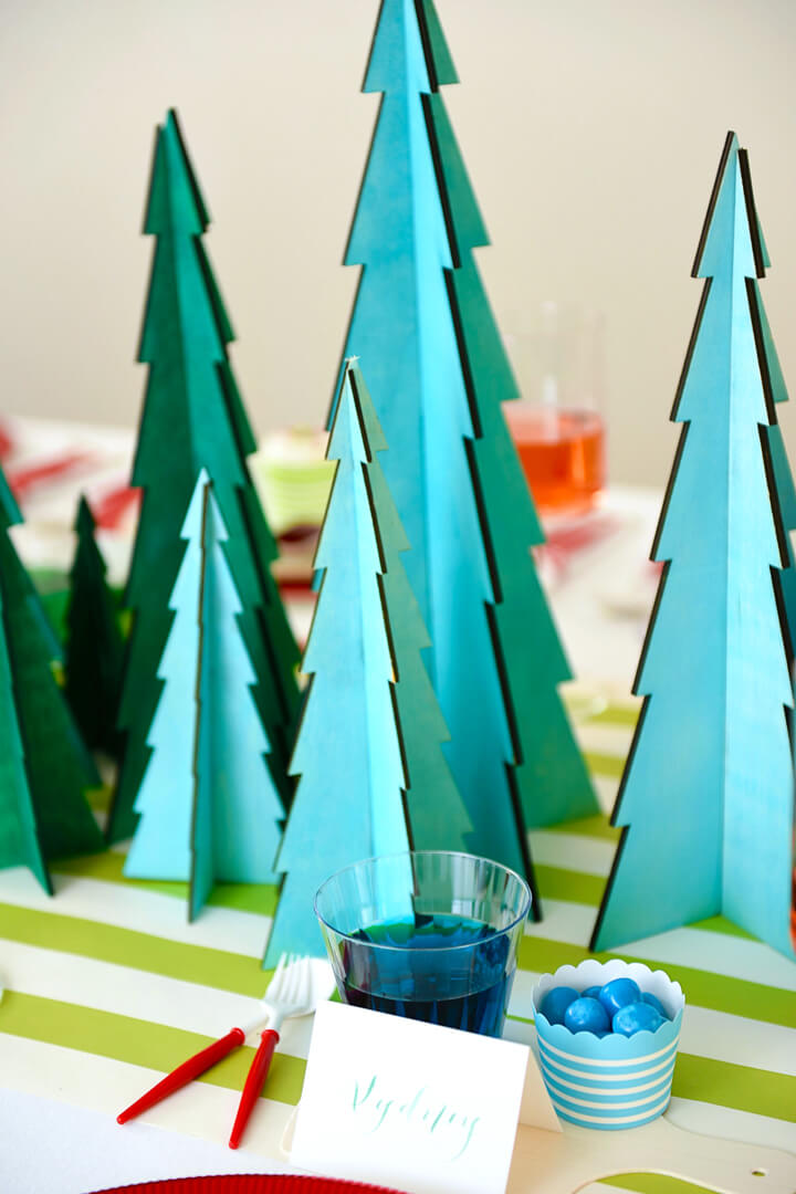Blue Treats and Christmas Tree from Rainbow Christmas Dinner Party Featuring Sophistiplate Styled by Table + Dine | Black Twine