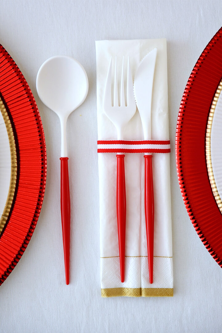 Red and White Flatware from Rainbow Christmas Dinner Party Featuring Sophistiplate Styled by Table + Dine | Black Twine