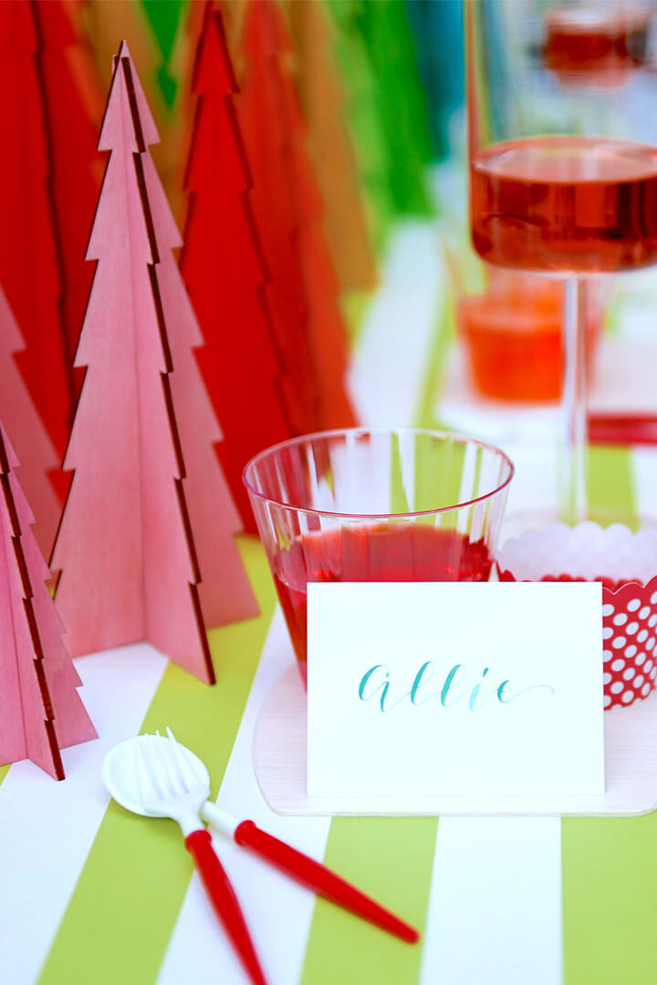 Red Drink, Name Card and Christmas Trees from Rainbow Christmas Dinner Party Featuring Sophistiplate Styled by Table + Dine | Black Twine