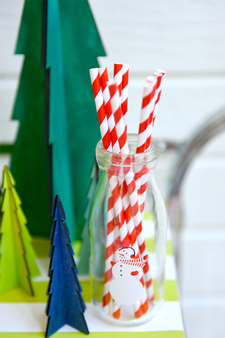 Red and White Straws with Christmas Trees from Rainbow Christmas Dinner Party Featuring Sophistiplate Styled by Table + Dine | Black Twine