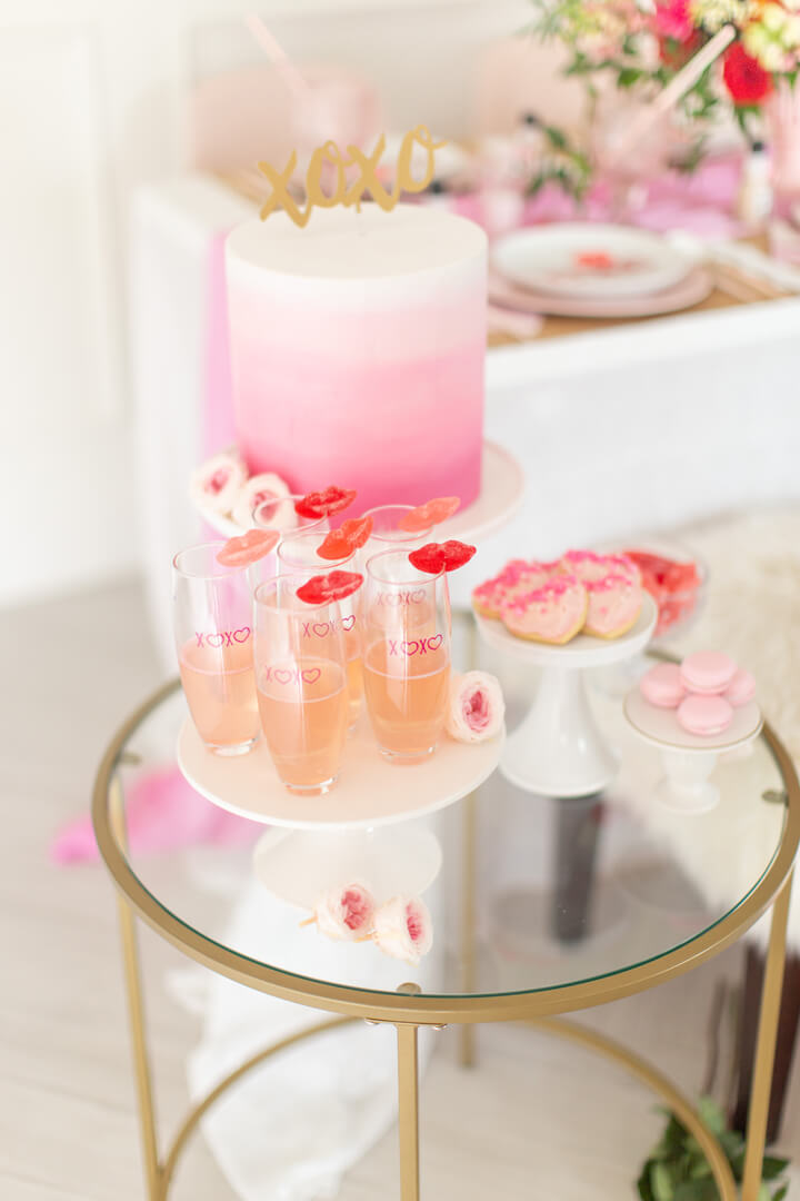 Cake, Macarons, Heart-Shaped Cookies and Drinks from Galentine's Day Party Styled by Celebration Stylist | Black Twine
