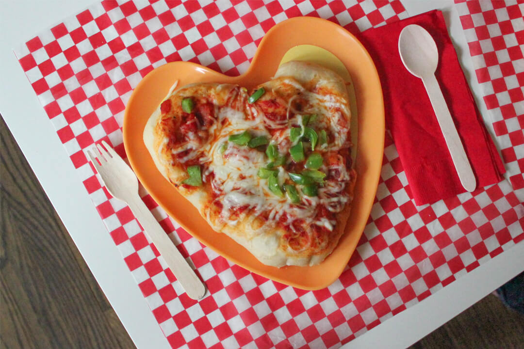 Heart-Shaped Pizza from I Love You to Pizzas Valentine's Party Styled by Just Add Confetti | Black Twine