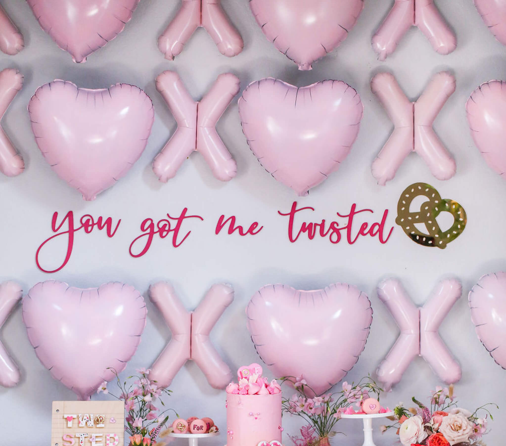 """DIY XOXO Balloon Backdrop from """"You Got Me Twisted"""" Valentine's Day Party Styled by Golden Arrow Events & Design   Black Twine"""