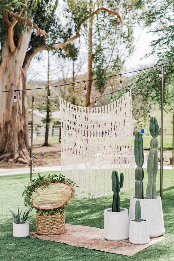 Macrame Backdrop from Stay Wild, My Child Baby Shower by The Revelry Co | Black Twine
