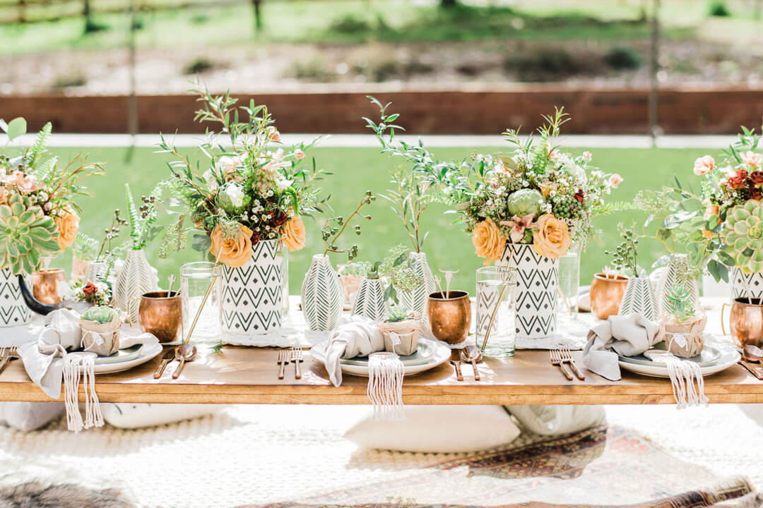 Tablescape with Floral Arrangement from Stay Wild, My Child Baby Shower by The Revelry Co | Black Twine